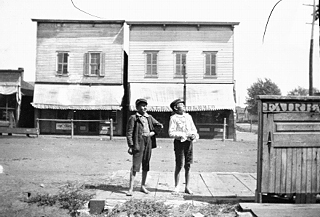 Two unidentified boys facing the Coalfield Store, circa 1896