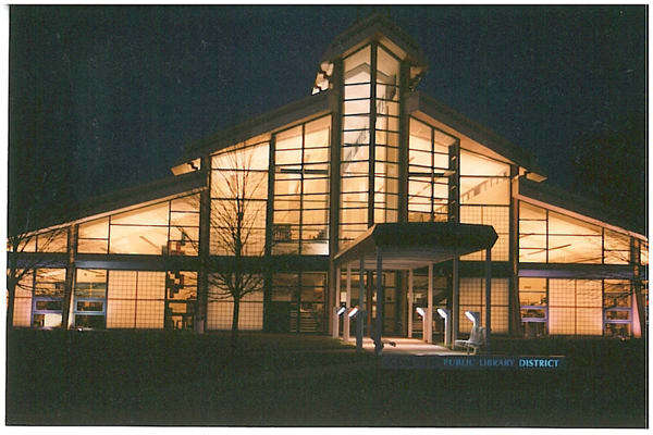 Image of the Coal City Public Library District building in the evening.